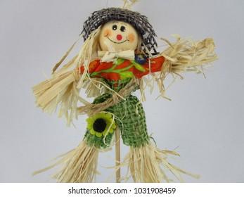 cute scarecrow figure on a stick