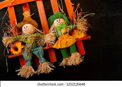 cute scarecrows figure on a stick