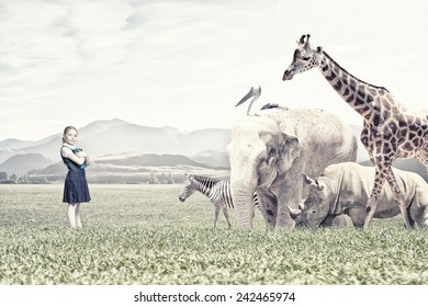 Cute school girl outdoor with wild animals
