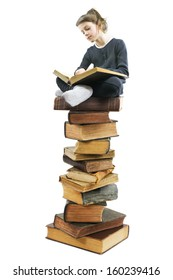 cute school girl standing on pile of books