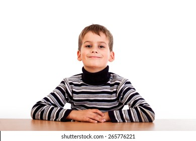 Cute schoolboy isolated on a white background