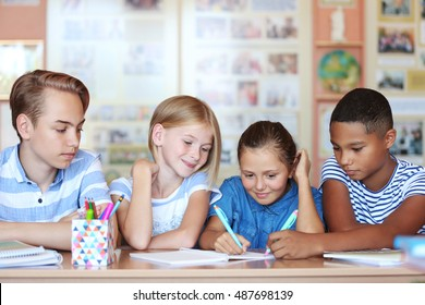 Cute schoolchildren in classroom on lesson