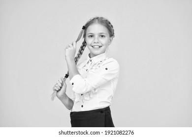 Cute schoolgirl with long hair. Graduation concept. Primary education. Perfect schoolgirl. Welcome back to school. Small schoolgirl with happy smile. Little schoolgirl looking nice in school uniform.