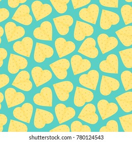 Cute seamless pattern with yellow hearts made of tortillas