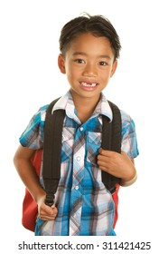 Cute Seven Year Old Filipino Boy On a white Background with a back pack and a smile because he is ready for school