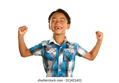 Cute Seven Year Old Filipino Boy On a white Background with an excited expression and his fists in the air