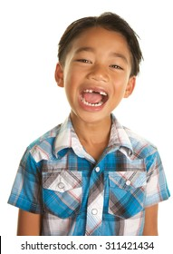 Cute Seven Year Old Filipino Boy On a white Background with his mouth open wide showing the gap where his two front teeth are missing