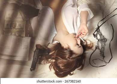 Cute and sexy woman with a cigarette, weapon and money