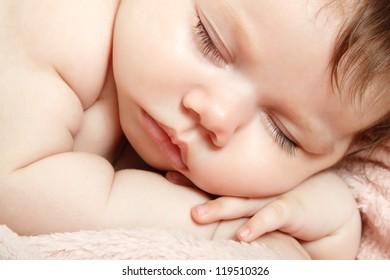 cute sleeping baby, beautiful kid's face closeup, studio shot