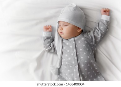 Cute sleeping baby in the bed