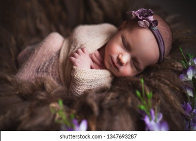 Cute sleeping baby, newborn and mothercare concept. Infant baby girl sleeping at background
