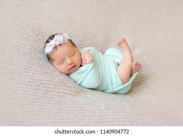 Cute sleeping newborn baby girl