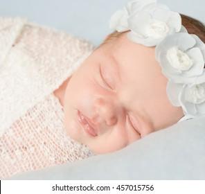 cute sleeping newborn girl close-up