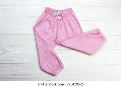 Cute sleepwear pants for girl. Cotton fabric with fine pattern. Trendy pajama and nightgowns.