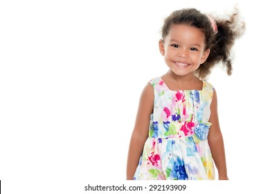 Cute small african-american or hispanic girl wearing a flowers summer dress isolated on white