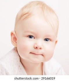 Cute small blond baby with blue eyes