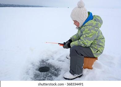 Cute small blonde girl fishing