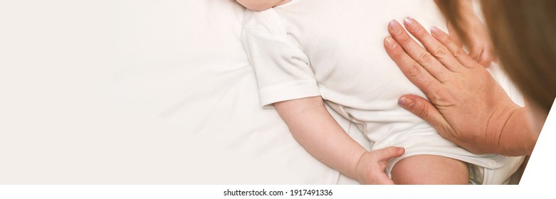 Cute small boy lying at bed. Childhood concept. Light background. Serious child. Copyspace. Stay home. Mockup. Horizontal banner. Massage. White clothes