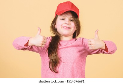 Cute small child gesturing approval sign and feeling pleasure. Adorable little girl showing approval hand gesture with pleasure.