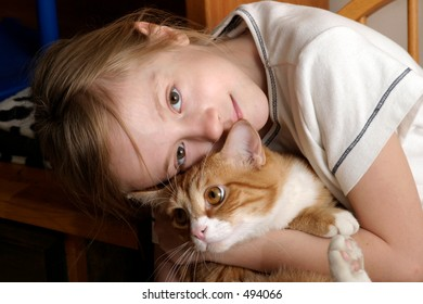 cute small girl holding cat