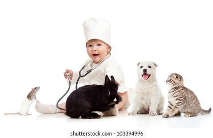 Cute small kid doctor examining pets dog, cat, bunny and rat