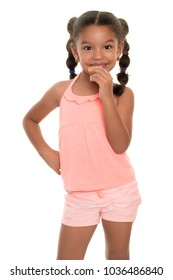 Cute small multiracial girl  eating a cookie - Isolated on white