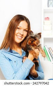Cute small Yorkshire Terrier with  smiling woman