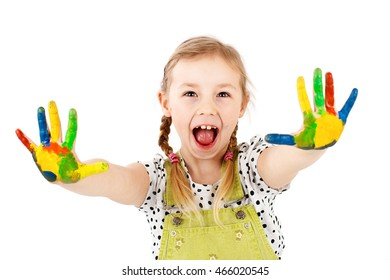 Cute and smart child playing with watercolors