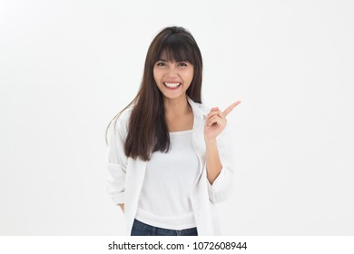 Cute and smart  young Thai girl smiling and put white shirt in relax lifestyle isolates on white background