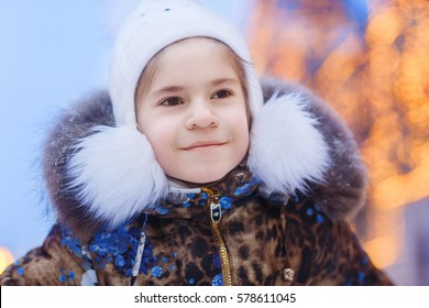 Cute and smile girl outdoor. Winter. Holiday