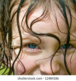 cute smile of pretty girl portrait with wet hair from summer fun