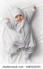 Cute smiling baby in bed after sleep
