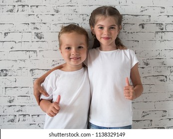 cute smiling boy and girl hugging each other, children in blank white T-shirts