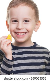 Cute smiling boy with jelly candy on isolated white