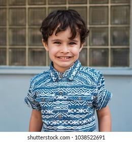 Cute smiling boy outdoor portrait.