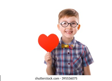 cute smiling boy with a valentine in the hands on a white background