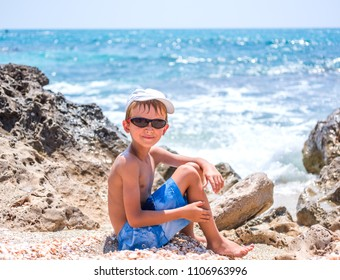 Cute smiling child on the sea beach. Family summer holiday vacat