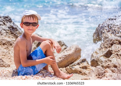 Cute smiling child on the sea beach. Family summer holiday vacation