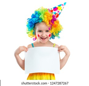 Cute smiling girl in clown wig is holding blank banner, isolated on a white backgroung. Space for text, copyspace