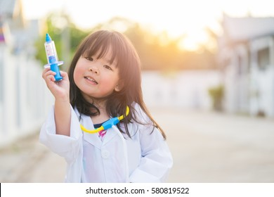 Cute smiling girl dressed like a doctor.