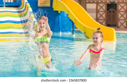 Cute smiling girl is enjoying clean water in the swimming pool