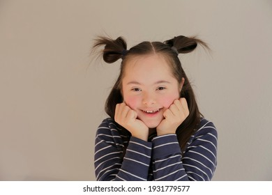 Cute smiling girl isolated on the grey background