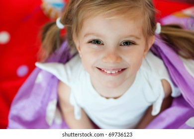 Cute smiling girl on the bed