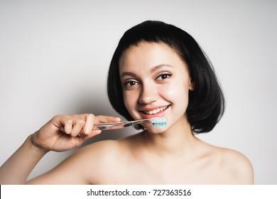 cute smiling girl will brush her teeth blue brush