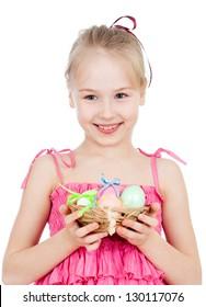 cute smiling kid girl holding Easter eggs in basket