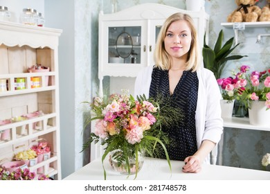 A cute smiling lady in her flowershop
