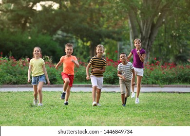 Cute smiling little children playing in park