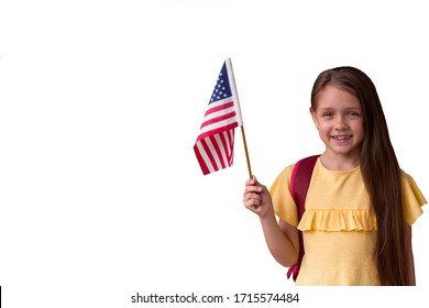 cute smiling little girl holding american flag isolated on white background,copy space