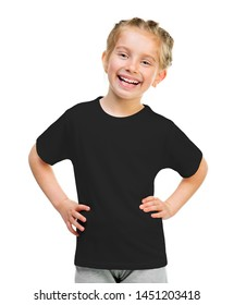 Cute smiling little girl on black t-shirt isolated on a white background
