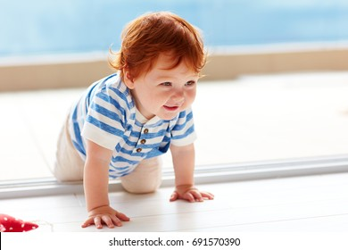 cute smiling toddler baby crawling on the floor
